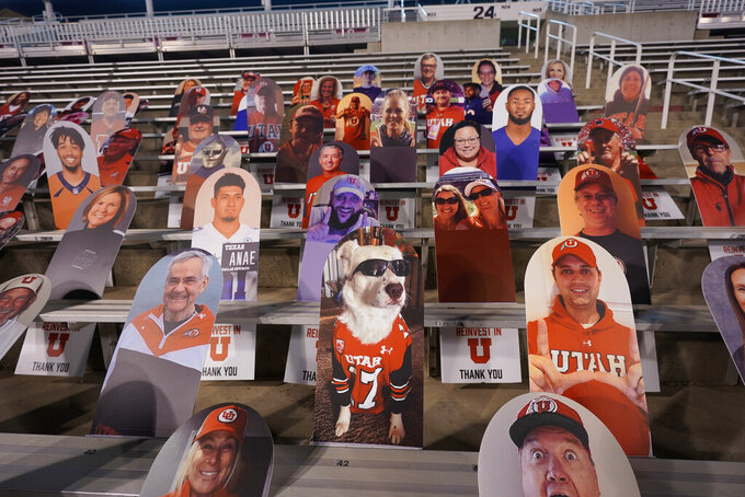 Cardboard cutouts are displayed in the seats before an NCAA college football game between Oregon State and Utah, Saturday, Dec. 5, 2020, in Salt Lake City. (AP Photo/Rick Bowmer)