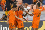 Houston Dynamo's Fafa Picault, center, is surrounded after his second goal of the game by team mates, from left, Memo Rodriguez, Griffin Dorsey and Darwin Ceren during the second half of an MLS soccer match against Austin FC Saturday, Sept. 11, 2021, in Houston. (AP Photo/Michael Wyke)