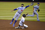 Arizona Diamondbacks' David Peralta (6) advances safely to second on a wild pitch as Los Angeles Dodgers' Mookie Betts (50) can't catch a throwing error by catcher Austin Barnes during the second inning of a baseball game, Thursday, Sept. 10, 2020, in Phoenix. (AP Photo/Matt York)