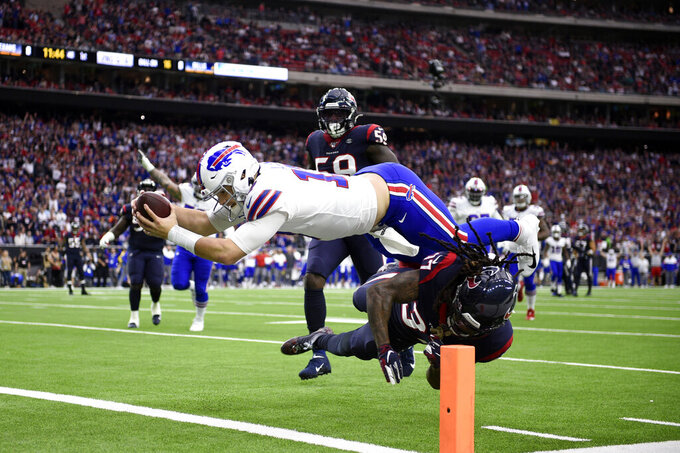 Buffalo Bills quarterback Josh Allen (17) dives to score a touchdown after catching a pass as Houston Texans strong safety Jahleel Addae (37) defends during the first half of an NFL wild-card playoff football game Saturday, Jan. 4, 2020, in Houston. (AP Photo/Eric Christian Smith)