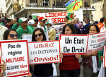 Algerian protesters gather during an anti-government demonstration in the centre of the capital Algiers, Algeria, Friday, June 7, 2019. Banner in French reads