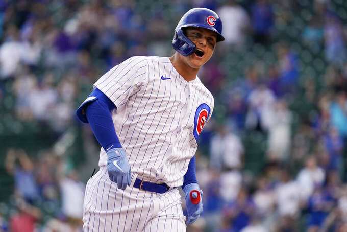 Chicago Cubs' Joc Pederson reacts as he rounds the bases after hitting a solo home run during the eighth inning of a baseball game against the Milwaukee Brewers in Chicago, Wednesday, April 7, 2021. (AP Photo/Nam Y. Huh)