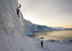 In this handout photo provided by British Antarctic Survey, carpenter Tom Lambert and Engineer Andy Stevenson-Jones climb ice at Hangar Cove, Rothera research station, in Antarctica on Friday, May 22, 2020. Antarctica remains the only continent without COVID-19 and now in Sept. 2020, as nearly 1,000 scientists and others who wintered over on the ice are seeing the sun for the first time in months, a global effort wants to make sure incoming colleagues don't bring the virus with them. (Robert Taylor/British Antarctic Survey via AP)