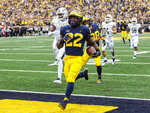 Michigan running back Karan Higdon (22) scores a 67-yard rushing touchdown in the first quarter of an NCAA college football game against Western Michigan in Ann Arbor, Mich., Saturday, Sept. 8, 2018. (AP Photo/Tony Ding)