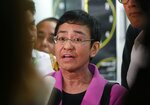 FILE - In this Jan. 22, 2018, file photo, Maria Ressa, CEO of the online news agency Rappler, talks to the media after attending the summons by the National Bureau of Investigation on the cyber libel complaint filed against Rappler five years ago in Manila, Philippines. Philippine authorities have arrested Ressa, Wednesday, Feb. 13, 2019, over a libel complaint which Amnesty International has condemned as