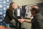 Catie Griggs, left, talks to the press after being introduced as the Seattle Mariners' new president of business operations during a baseball a press conference on Wednesday, July 28, 2021, (AP Photo/Jason Redmond)