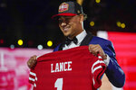 North Dakota State quarterback Trey Lance holds a San Francisco 49ers jersey after being chosen by the team with the third pick in the NFL football draft, Thursday April 29, 2021, in Cleveland. (AP Photo/Tony Dejak)