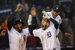 Detroit Tigers' Robbie Grossman is greeted bu Jeimer Candelario, left, and Miguel Cabrera after two-run walk-off home run during the 10th inning of a baseball game against the New York Yankees, Friday, May 28, 2021, in Detroit. (AP Photo/Carlos Osorio)