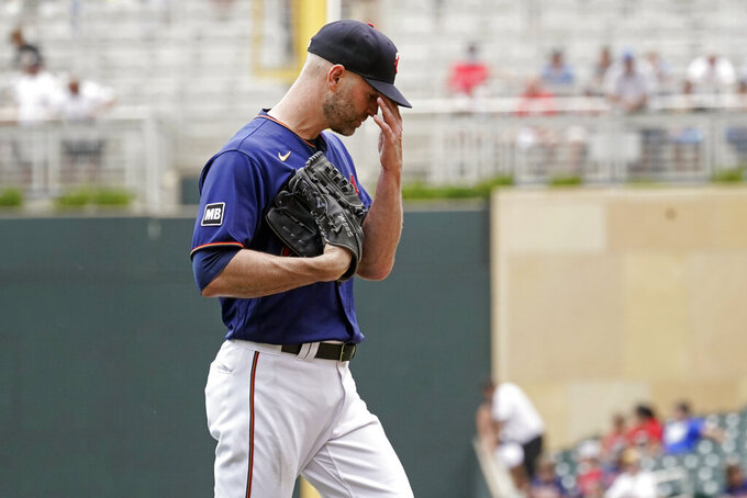 Minnesota Twins pitcher J.A. Happ heads to the dugout after he was pulled in the fourth inning of a baseball game against the Detroit Tigers, Wednesday, July 28, 2021, in Minneapolis. (AP Photo/Jim Mone)