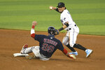 Miami Marlins shortstop Miguel Rojas throws to first after forcing out Boston Red Sox's Alex Verdugo at second during the sixth inning of a baseball game, Thursday, Sept. 17, 2020, in Miami. (AP Photo/Gaston De Cardenas)