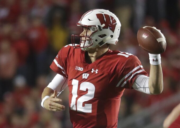 FILE - In this Oct. 6, 2018 file photo, Wisconsin's Alex Hornibrook throws during the first half of an NCAA college football game against Nebraska in Madison, Wis.  James Blackman was Florida State's starter in 2017, but Blackman acknowledges he's in an open competition with Wisconsin transfer Alex Hornibrook and others. Hornibrook completed 60 percent of his passes and led the Badgers to a 26-6 mark as their starter. (AP Photo/Morry Gash)