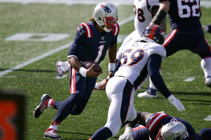 New England Patriots quarterback Cam Newton (1) runs for yardage against the Denver Broncos in the first half of an NFL football game, Sunday, Oct. 18, 2020, in Foxborough, Mass. (AP Photo/Charles Krupa)