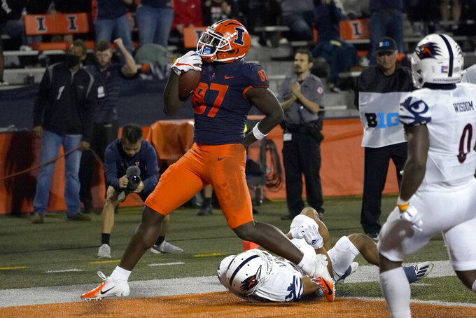 Illinois tight end Daniel Barker celebrates his touchdown reception during the second half of an NCAA college football game against UTSA, Saturday, Sept. 4, 2021, in Champaign, Ill. (AP Photo/Charles Rex Arbogast)