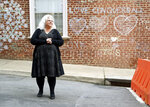 Susan Bro stands near the spot where her daughter, Heather Heyer, was killed after a car drove into a group of people protesting a white nationalist rally on Aug. 12  before a ceremony dedicating part of 4th Street to her memory on Wednesday, Dec. 20, 2017, in Charlottesville, Va. (Zack Wajsgras/The Daily Progress via AP)