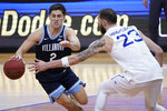 Villanova guard Collin Gillespie (2) drives against Seton Hall forward Sandro Mamukelashvili (23) during the second half of an NCAA college basketball game, Saturday, Jan. 30, 2021, in Newark, N.J. Villanova won 80-72. (AP Photo/Mary Altaffer)