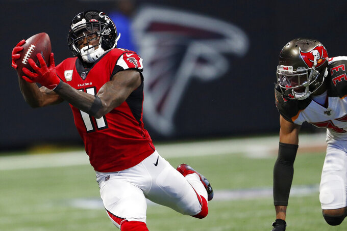 Atlanta Falcons wide receiver Julio Jones (11) makes the catch against Tampa Bay Buccaneers cornerback Carlton Davis (33) during the first half of an NFL football game, Sunday, Nov. 24, 2019, in Atlanta. (AP Photo/John Bazemore)