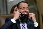 Deputy Attorney General Rod Rosenstein puts on a fake beard presented to him by Principle Associate Deputy Attorney General Edward O'Callaghan who received some notoriety for his beard, during a farewell ceremony how Rosenstein in the Great Hall at the Department of Justice in Washington, Thursday, May 9, 2019. Rosenstein is set to step down as Deputy Attorney General May 15. (AP Photo/Andrew Harnik)
