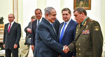 Israeli Prime Minister Benjamin Netanyahu, centre, shakes hands with Head of the General Staff of the Armed Forces of Russia and First Deputy Defense Minister Valery Gerasimov, right, as Russian President Vladimir Putin, left, looks on during their meeting at the Kremlin in Moscow, Wednesday, July 11, 2018. (Yuri Kadobnov/ Pool photo via AP)