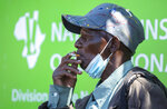 FILE — In this Tuesday, Aug. 25, 2020 file photo a man smokes a cigarette whist during protest against staff shortages and the lack of personal protective equipment outside the National Health Laboratory Services in Johannesburg, South Africa, South African Health Minister, Zwerli Mkhize announced Monday, Oct. 19 2020 that he and his wife have tested positive for COVID-19, warning of a possible resurgence of the disease in the country. (AP Photo/Themba Hadebe/File)