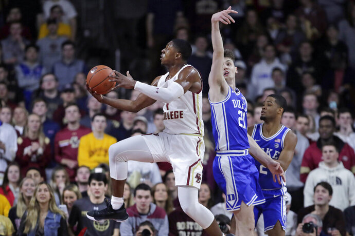 Boston College forward Jairus Hamilton (1) drives to the basket against Duke forward Matthew Hurt (21) during the first half of an NCAA college basketball game in Boston, Tuesday, Feb. 4, 2020. (AP Photo/Charles Krupa)