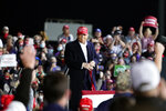 President Donald Trump listens to supporters during a campaign rally at Des Moines International Airport, Wednesday, Oct. 14, 2020, in Des Moines, Iowa. (AP Photo/Alex Brandon)