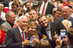 Vice President Mike Pence takes pictures with supporters during the Louisiana GOP Unity Rally in Kenner, La., Saturday, Oct. 5, 2019. Republicans are trying to keep  Gov. John Bel Edwards, the Deep South's only Democratic governor, from topping 50% of the vote and gaining outright victory in the Oct. 12 primary. In Louisiana, candidates run on the same ballot regardless of party. (Sophia Germer/The Advocate via AP)