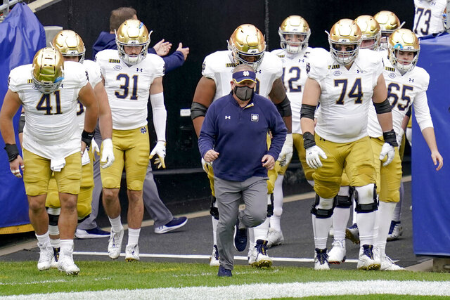 FILE - In this Oct. 24, 2020, file photo, Notre Dame head coach Brian Kelly, center, leads the team on to the field for an NCAA college football game against Pittsburgh in Pittsburgh. Kelly's second-ranked Fighting Irish visit No. 25 North Carolina on Friday. (AP Photo/Keith Srakocic, File)