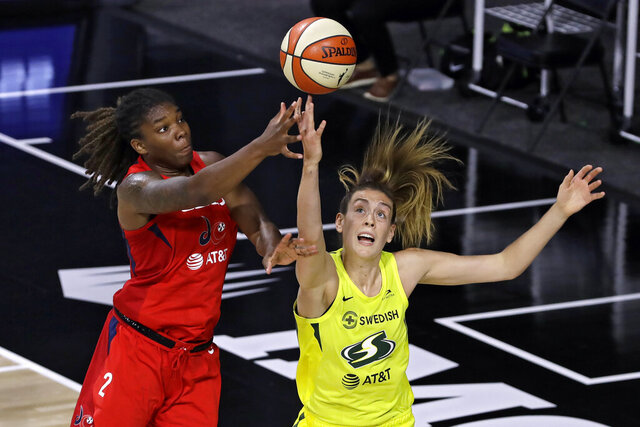 Washington Mystics forward Myisha Hines-Allen (2) goes up for a shot over Seattle Storm forward Breanna Stewart (30) during the first half of a WNBA basketball game Thursday, July 30, 2020, in Bradenton, Fla. (AP Photo/Chris O'Meara)