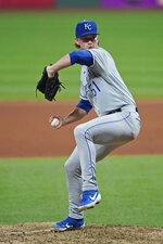 Kansas City Royals starting pitcher Brady Singer winds u during the seventh inning of the baseball team's game against the Cleveland Indians, Thursday, Sept. 10, 2020, in Cleveland. (AP Photo/Tony Dejak)