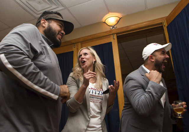 Lauren Witzke, center, celebrates after winning Delaware's Republican U.S. Senate primary, Tuesday, Sept. 15, 2020, in Dover, Del. Witzke, a political newcomer, defeated attorney James DeMartino to become the GOP nominee for the seat currently held by Democrat Chris Coons. (Andre Lamar/The News Journal via AP)