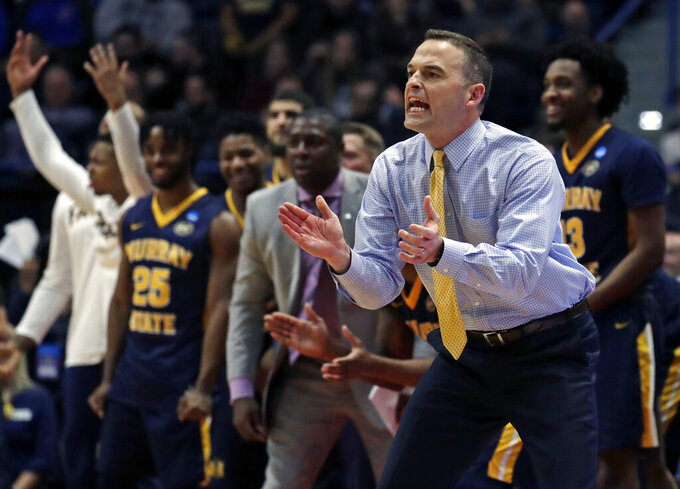 Murray State's head coach Matt McMahon, front right, reacts at the bench during the second half of a first round men's college basketball game against Marquette in the NCAA Tournament, Thursday, March 21, 2019, in Hartford, Conn. (AP Photo/Elise Amendola)