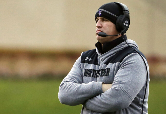FILE - In this Nov. 24, 2018, file photo, Northwestern head coach Pat Fitzgerald watches his team during the first half of an NCAA college football game against Illinois in Evanston, Ill. No. 21 Northwestern set to face No. 6 Ohio State in the Wildcats' first Big Ten championship game appearance on Saturday, Dec. 1, 2018, in what could be a signature moment for a consistent winner trying to earn its spot among the conference's elite. (AP Photo/Nam Y. Huh, File)