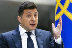 Ukrainian President Volodymyr Zelenskyy gestures while speaking to the media during a news conference at the Antonov aircraft factory in Kyiv, Ukraine, Thursday, May 20, 2021. (AP Photo/Efrem Lukatsky)