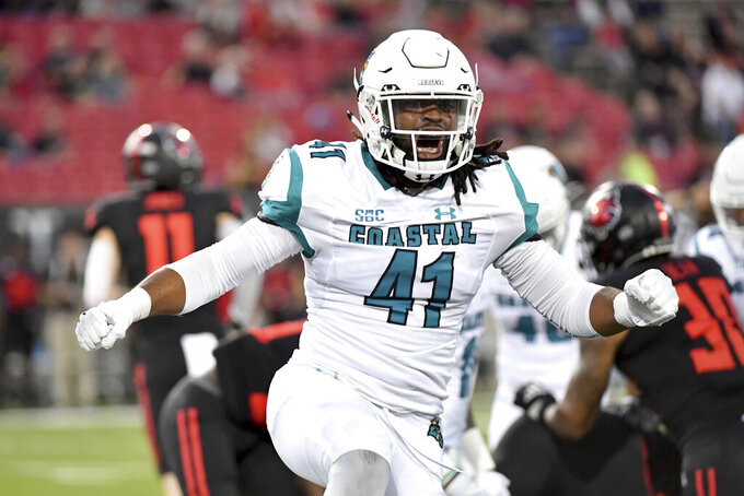 Coastal Carolina's Myles Olufemi (41) reacts after making a tackle against Arkansas State during the first half of an NCAA college football game Thursday, Oct. 7, 2021, in Jonesboro, Ark. (AP Photo/Michael Woods)