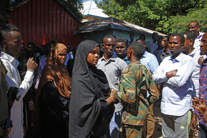 Ilwad Elman, center, who was reportedly shortlisted for this year's Nobel Peace Prize, attends the funeral service for her sister, Somali Canadian peace activist Almaas Elman, in the capital Mogadishu, Somalia Friday, Nov. 22, 2019. Preliminary investigations show Almaas Elman was killed by a stray bullet inside a heavily defended base near the international airport earlier this week in Mogadishu, the peacekeeping mission in Somalia said Friday. (AP Photo/Farah Abdi Warsameh)