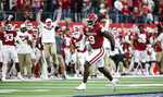 FILE - In this Dec. 7, 2019, file photo, Oklahoma linebacker Kenneth Murray (9) celebrates sacking Baylor quarterback Charlie Brewer, not pictured, during the Big 12 Championship NCAA college football game, in Arlington, Texas. Murray was selected to The Associated Press All-Big 12 Conference team, Friday, Dec. 13, 2019. (AP Photo/Brandon Wade, File)