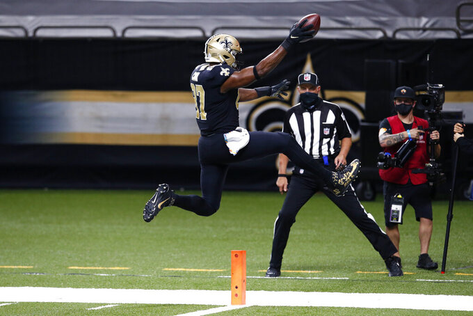 New Orleans Saints tight end Jared Cook (87) leaps into the end zone on a touchdown reception in the second half of an NFL football game against the Los Angeles Chargers in New Orleans, Monday, Oct. 12, 2020. (AP Photo/Butch Dill)