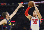 Detroit Pistons' Blake Griffin (23) shoots over Cleveland Cavaliers' Kevin Love (0) in the second half of an NBA basketball game, Tuesday, Dec. 3, 2019, in Cleveland. Detroit won 127-94. (AP Photo/Tony Dejak)