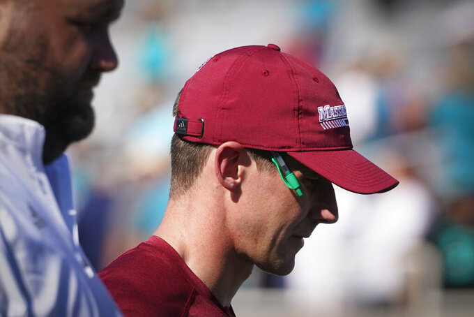Massachusetts head coach Walt Bell leaves the field after their loss against Coastal Carolina during the second half of an NCAA college football game on Saturday, Sept. 25, 2021, in Conway, S.C. (AP Photo/Chris Carlson)
