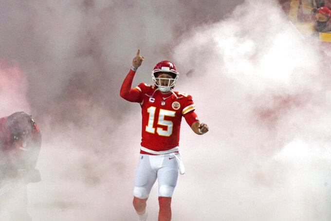 Kansas City Chiefs quarterback Patrick Mahomes runs onto the field before the AFC championship NFL football game against the Buffalo Bills, Sunday, Jan. 24, 2021, in Kansas City, Mo. (AP Photo/Charlie Riedel)