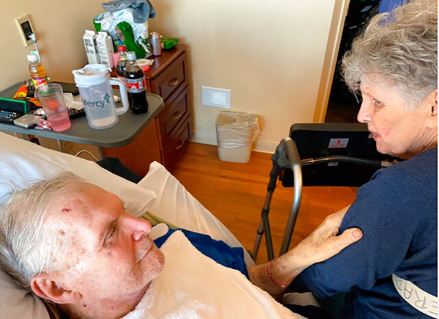 In this November 2019 photo provided by Sue Wagener shows Jack and Harriet Morrison. The couple who had been together for nearly 65 years have died on the same day at a St. Louis area nursing home. The Morrison's beds were placed next to each other in their final hours, allowing them to hold hands, the†St. Louis Post-Dispatch†reports.†86 year-old Jack died first. Harriett, who was 83, died later on Jan. 11 2020.†(Photo Courtesy Sue Wagener via AP)