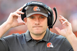 FILE - In this Dec. 22, 2019, file photo, Cleveland Browns defensive line coach Tosh Lupoi reacts during an NFL football game against the Baltimore Ravens, Sunday,, in Cleveland.  Lupoi is joining the Atlanta Falcons' staff as a defensive line and run game coordinator, focusing on defensive ends, the team announced. This past season, Lupoi was defensive line coach for the Cleveland Browns. (AP Photo/David Richard, File)
