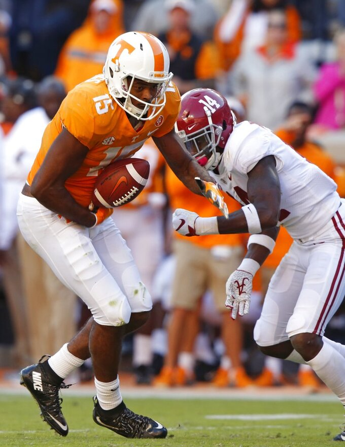 Tennessee wide receiver Jauan Jennings (15) fumbles the ball as he's pressured by Alabama defensive back Deionte Thompson (14) in the first half of an NCAA college football game Saturday, Oct. 20, 2018, in Knoxville, Tenn. (AP Photo/Wade Payne)