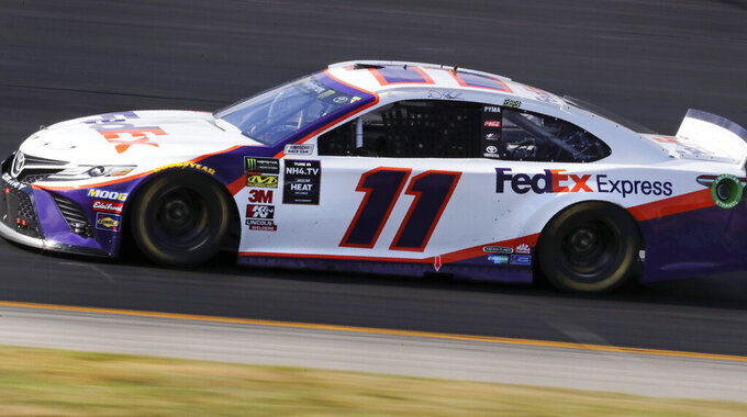 Denny Hamlin heads down the front straight during a NASCAR Cup Series auto race at New Hampshire Motor Speedway in Loudon, N.H., Sunday, July 21, 2019. (AP Photo/Charles Krupa)