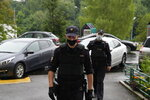 """Police at the scene at the apartment block, where Roman Dobrokhotov, the chief editor of The Insider lives, in Moscow, Russia, Wednesday, July 28, 2021 . Police in Russia raided the home of the chief editor of an investigative media outlet that was recently designated as a """"foreign agent,"""" the latest step by authorities to raise pressure on independent media ahead of the country's September parliamentary election. (AP Photo/Alexander Zemlianichenko)"""