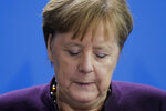"""FILE - In this Feb. 20, 2020, file photo, German Chancellor Angela Merkel gives a statement at the chancellery in Berlin following a shooting in the city of Hanau. In the wake of the latest spasm of violence, Merkel denounced the """"poison"""" of racism and hatred in Germany, and other politicians similarly condemned the shootings. (AP Photo/Markus Schreiber, File)"""