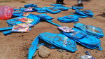 Children's backpacks lie at the site a day after an airstrike in Saada, Yemen on Friday, Aug. 10, 2018. Yemen's Shiite rebels are backing a United Nations' call for an investigation into a Saudi-led coalition airstrike in the country's north that killed dozens of people the previous day, including many children.(AP Photo/Kareem al-Mrrany)