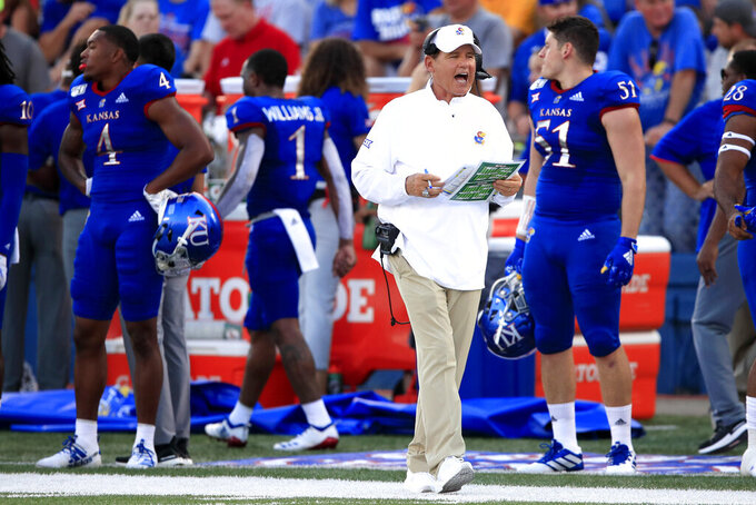 Kansas head coach Les Miles works the sidelines during the first half of an NCAA college football game against Coastal Carolina in Lawrence, Kan., Saturday, Sept. 7, 2019. (AP Photo/Orlin Wagner)