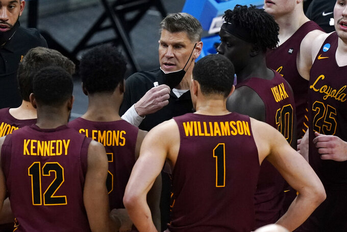 Loyola of Chicago head coach Porter Moser talks to his players during the second half of a college basketball game against Illinois in the second round of the NCAA tournament at Bankers Life Fieldhouse in Indianapolis Sunday, March 21, 2021. (AP Photo/Mark Humphrey)
