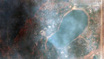 This satellite image provided by Maxar Technologies shows a natural color photo of the Lake of the Pines neighborhood and Allens Lake, Tuesday, Oct. 20, 2020, after the CalWood Fire burned through the area, west of Longmont, Colo., in Boulder County. (Satellite image ©2020 Maxar Technologies via AP)